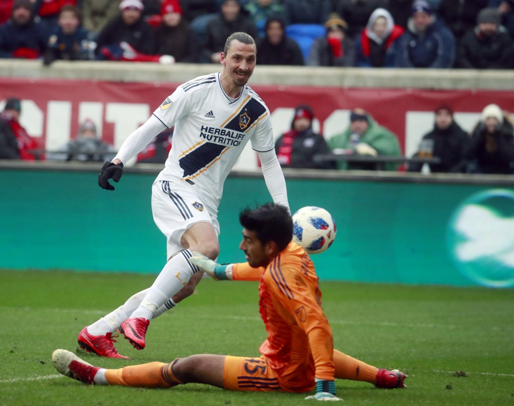 Chicago Fire goalkeeper Richard Sanchez (45), makes a save on a shot at close range by Los Angeles Galaxy forward Zlatan Ibrahimovic (9), during the f
