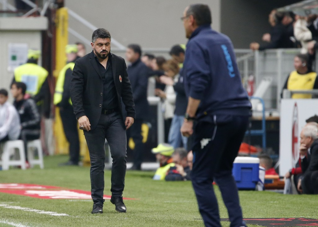 AC Milan coach Gennaro Gattuso, left, walks the pitch during the Serie A soccer match between AC Milan and Napoli at the San Siro stadium in Milan, It