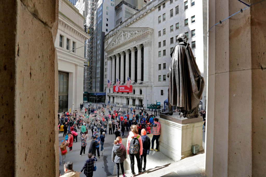 FILE- In this April 5, 2018, file photo, a statue of George Washington, on the steps Federal Hall, overlooks the New York Stock Exchange. The U.S. sto