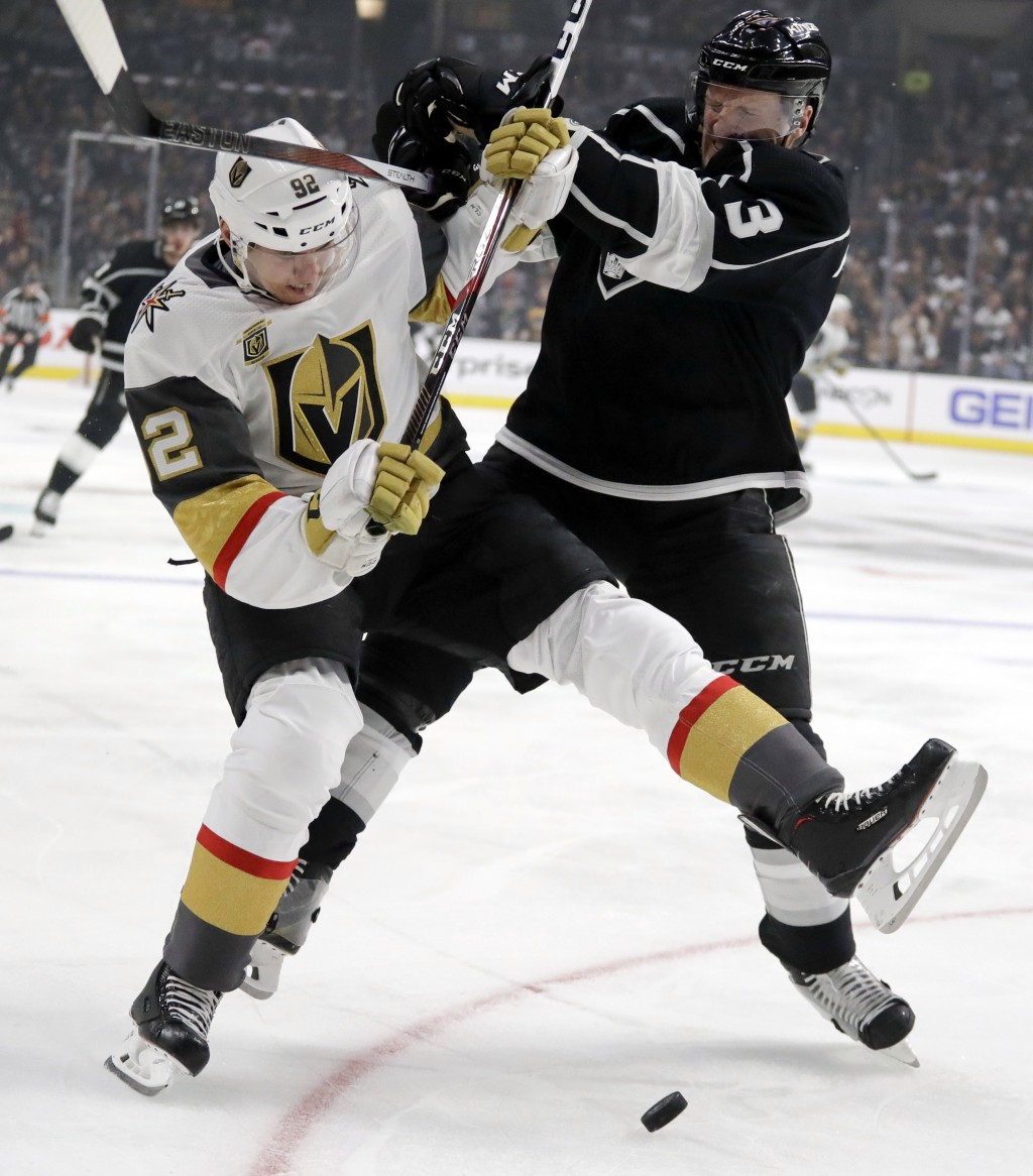 Vegas Golden Knights left wing Tomas Nosek, left, battles Los Angeles Kings defenseman Dion Phaneuf for the puck during the first period of Game 3 of