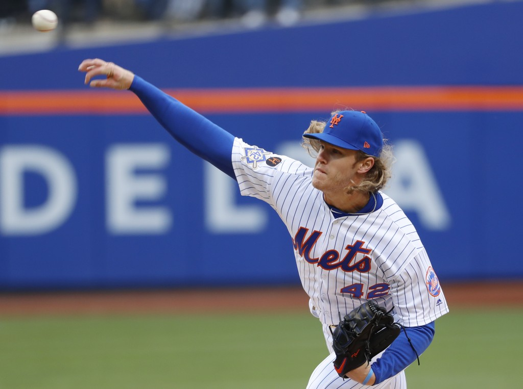 New York Mets starting pitcher Noah Syndergaard delivers in the first inning of a baseball game against the Milwaukee Brewers, Sunday, April 15, 2018,