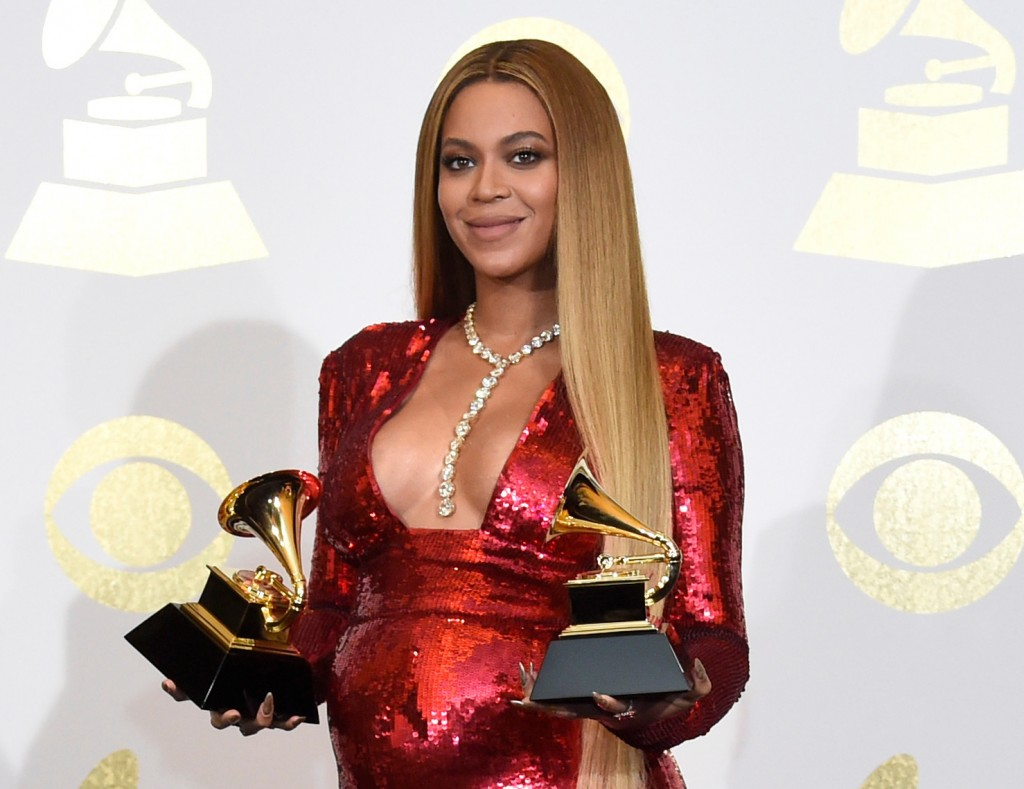 "FILE - In this Feb. 12, 2017 file photo, Beyonce poses in the press room with the awards for best music video for ""Formation"" and best urban contempor"