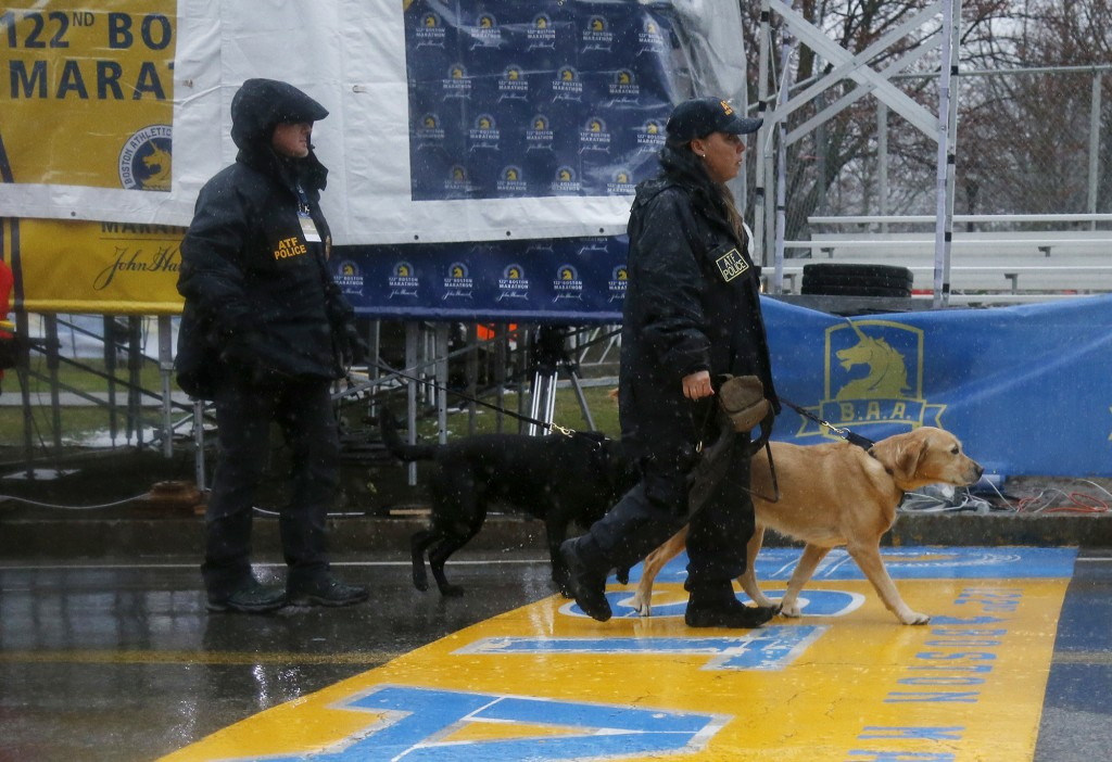 ATF K-9 units cross the start line during a security patrol before the start of the 122nd running of the Boston Marathon in Hopkinton, Mass., Monday,