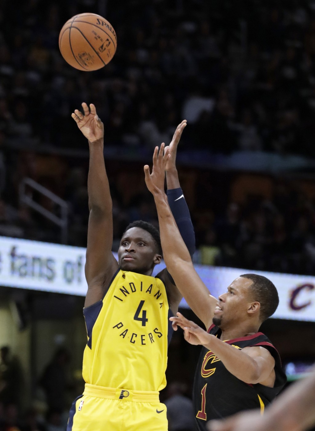 Indiana Pacers' Victor Oladipo (4) shoots against Cleveland Cavaliers' Rodney Hood (1) in the second half of Game 1 of an NBA basketball first-round p