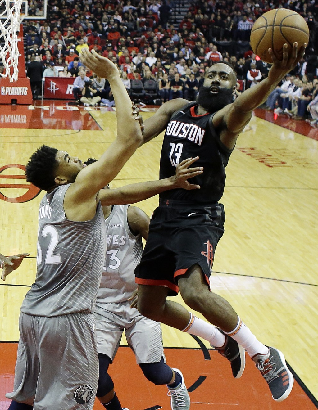 Houston Rockets' James Harden shoots over Minnesota Timberwolves' Karl-Anthony Towns during the first half in Game 1 of a first-round NBA basketball p