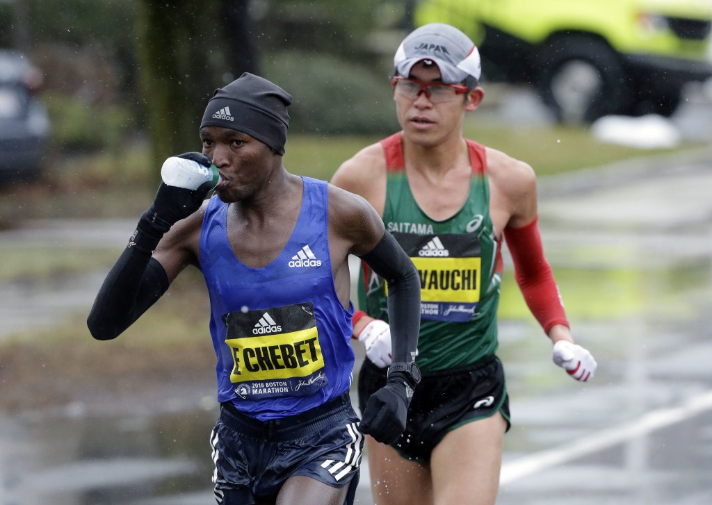 Evans Chebet, of Kenya, leads Yuki Kawauchi, of Japan, as the men's elite field of runners compete in the 122nd Boston Marathon on Monday, April 16, 2