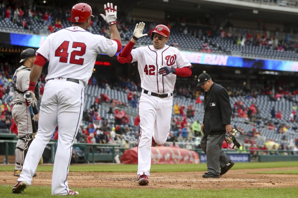 Washington Nationals' Moises Sierra, left, high fives Matt Wieters after he hits a home run during the sixth inning of a baseball game against the Col