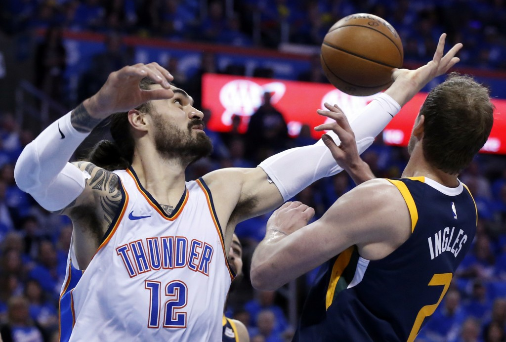 Oklahoma City Thunder center Steven Adams (12) reaches for a rebound with Utah Jazz forward Joe Ingles (2) in the first half of Game 1 of an NBA baske