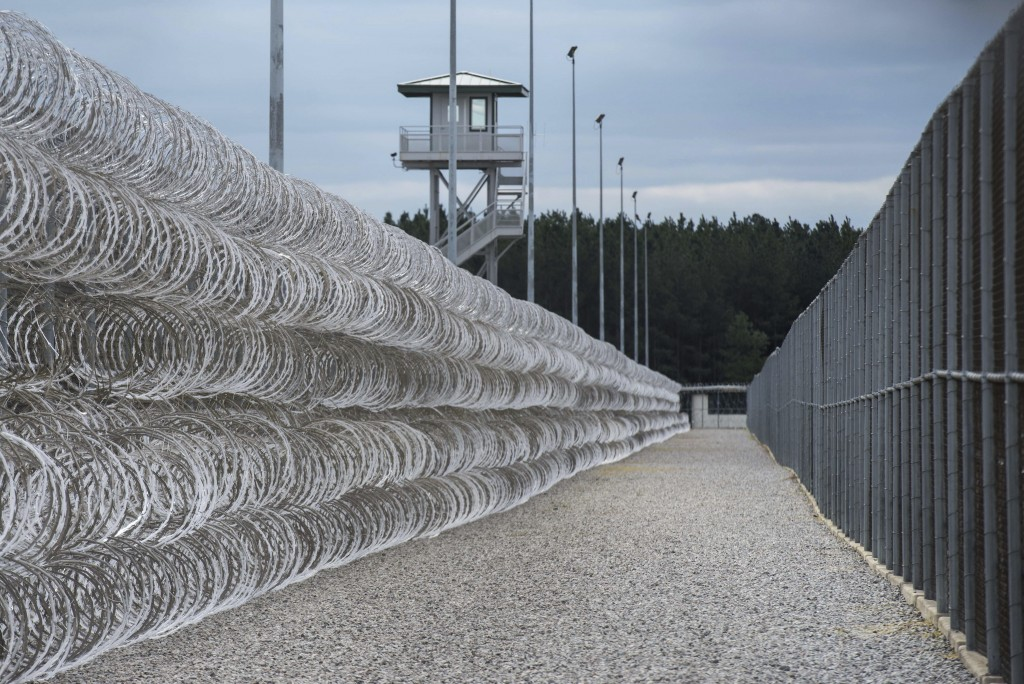 FILE - In this Feb. 9, 2016, file photo, razor wire protects a perimeter of the Lee Correctional Institution in Bishopville, S.C. A South Carolina pri