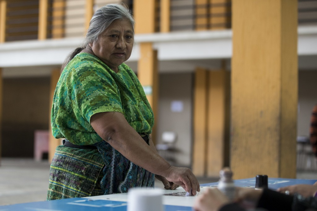 Juliana Chacat, 62, casts her vote during a plebiscite concerning a border dispute with Belize, in San Pedro Sacatepequez, Guatemala, Sunday, April 15