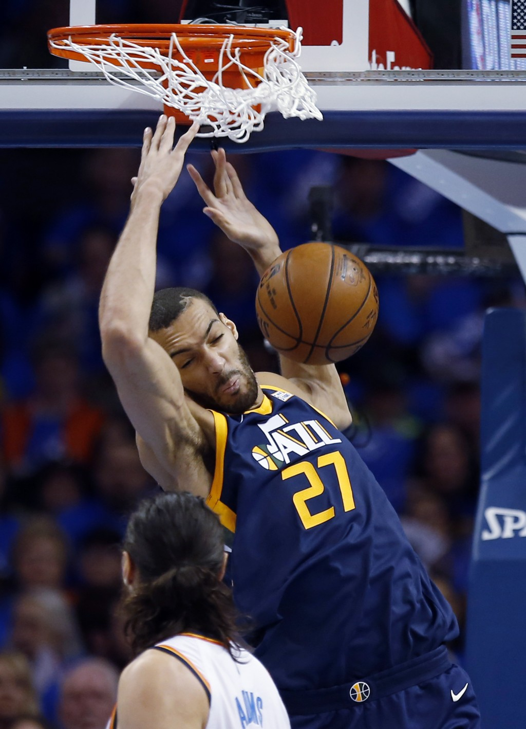 Utah Jazz center Rudy Gobert (27) dunks in front of Oklahoma City Thunder center Steven Adams in the first half of Game 1 of an NBA basketball first-r