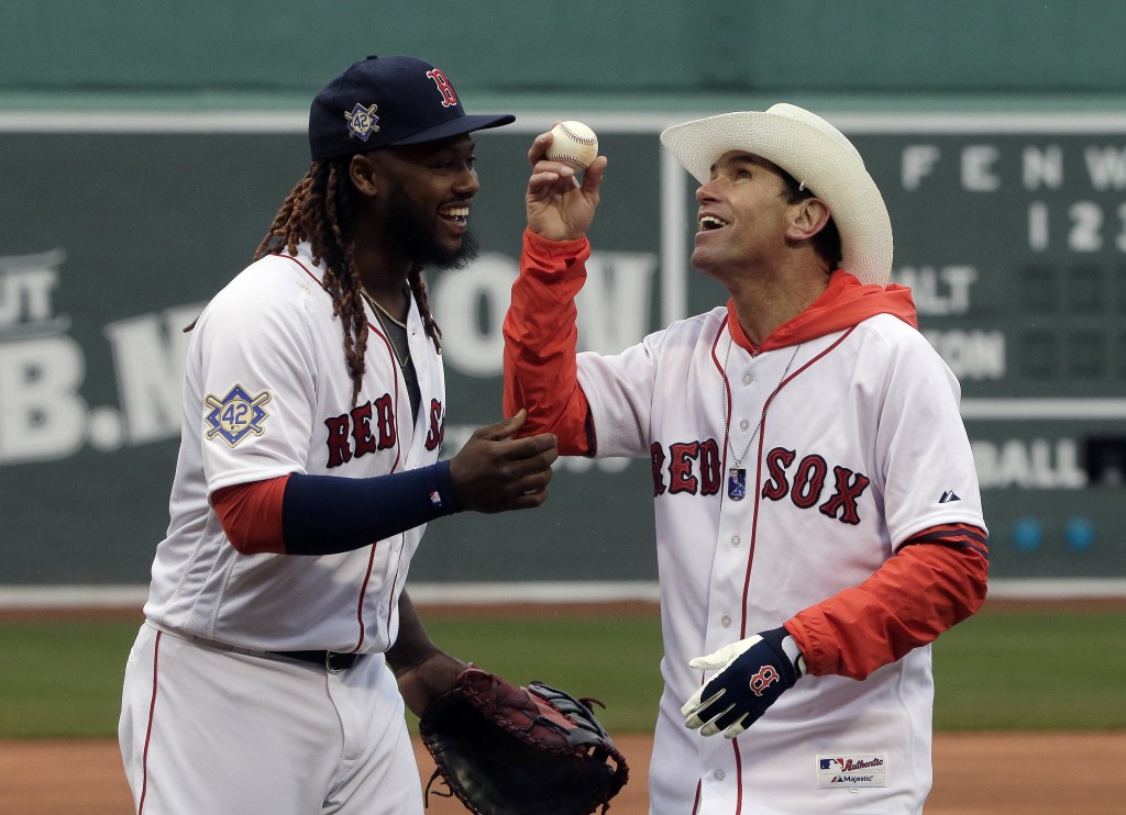 Boston Red Sox's Hanley Ramirez, left, speaks with Carlos Arredondo, right, after Arredondo threw out a ceremonial first pitch before the start of a b