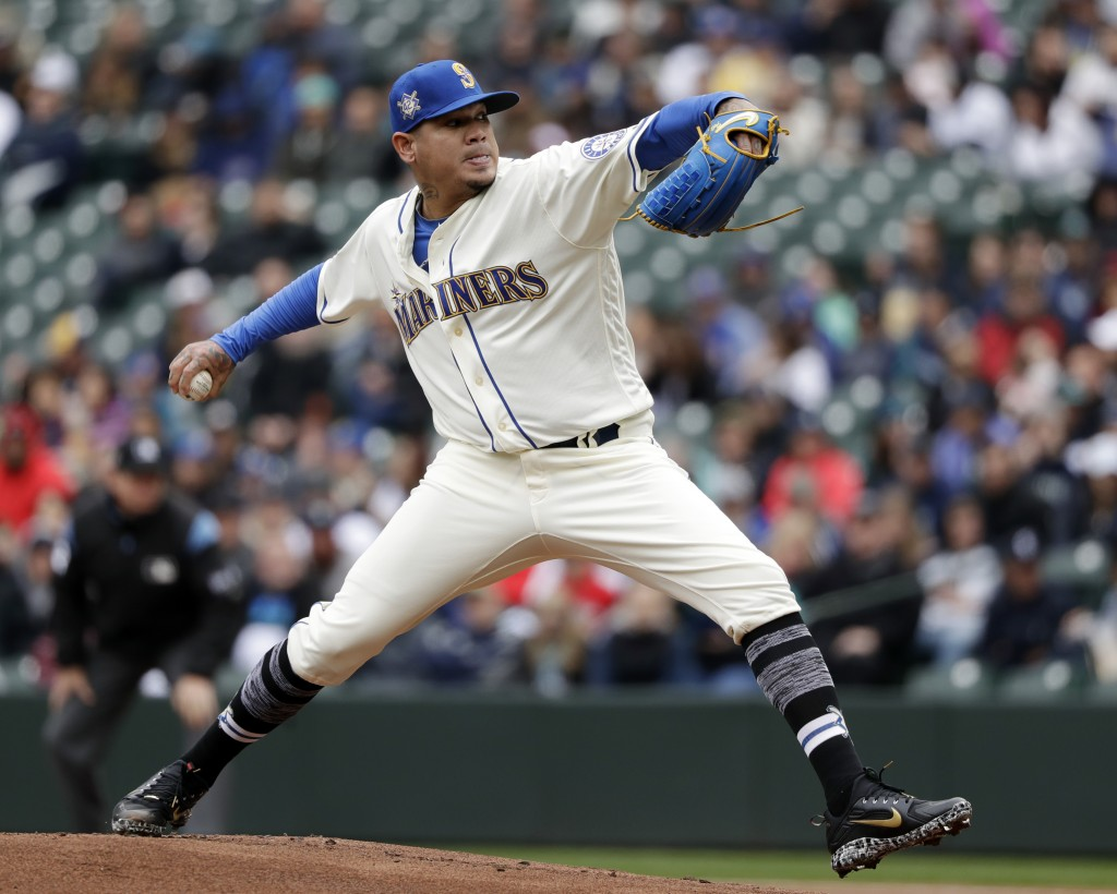 Seattle Mariners starting pitcher Felix Hernandez throws against the Oakland Athletics in the first inning during a baseball game Sunday, April 15, 20
