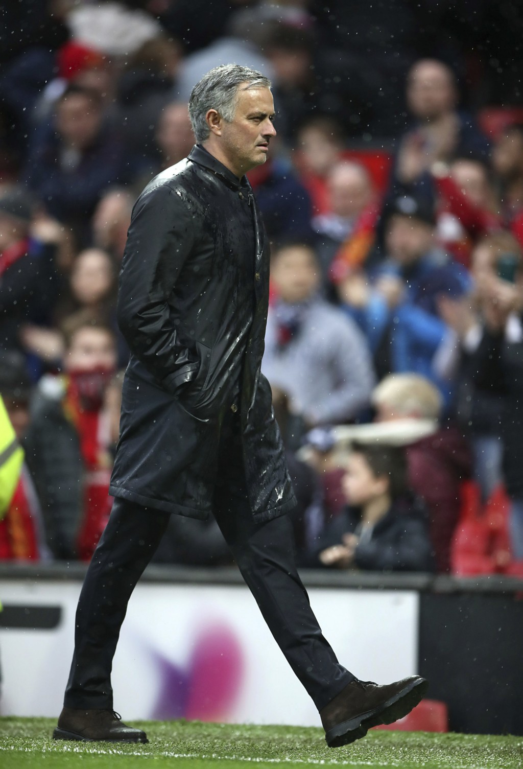 Manchester United manager Jose Mourinho leaves the pitch after the final whistle of the English Premier League soccer match against West Bromwich Albi