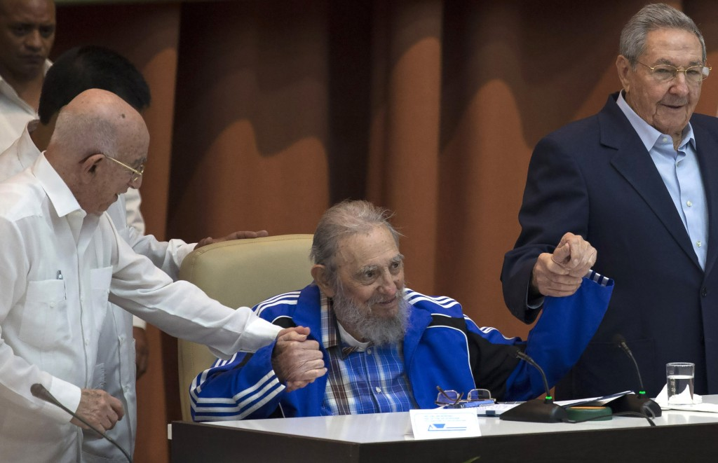 FILE - This April 19, 2016 file photo shows a rare public appearance by Fidel Castro, supported by Cuban President Raul Castro, right, and second secr