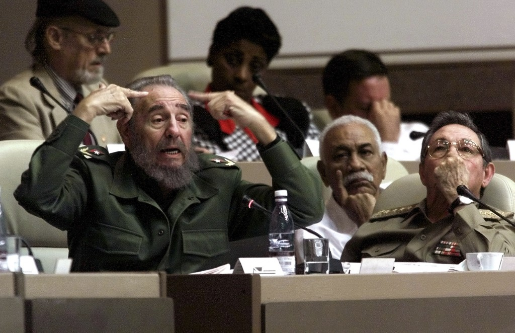 FILE - In this Dec. 20, 2001 file photo, Cuban leader Fidel Castro delivers a speech seated next to his brother, Defense Minister and first Vice Presi