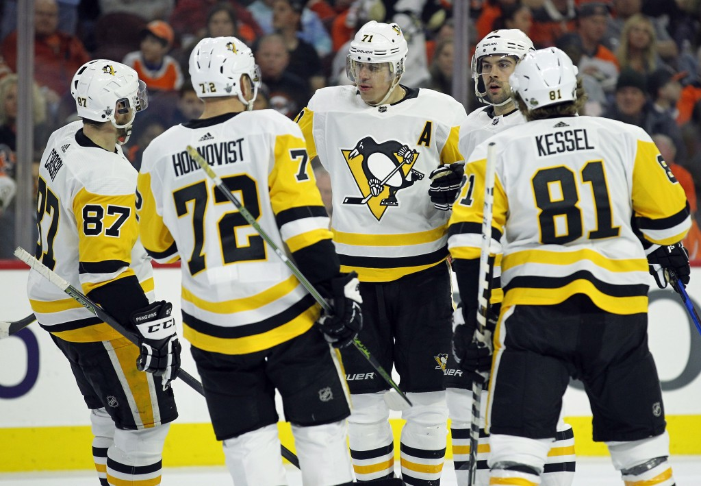 Pittsburgh Penguins', from left to right, Sidney Crosby, Patric Hornqvist, Evgeni Malkin, Justin Schultz and Phil Kessel, gather to celebrate Schultz'