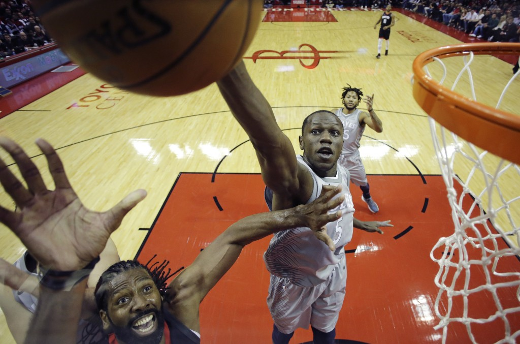 Minnesota Timberwolves' Gorgui Dieng, right, tries to block a shot by Houston Rockets' Nene Hilario, left, during the first half in Game 1 of a first-