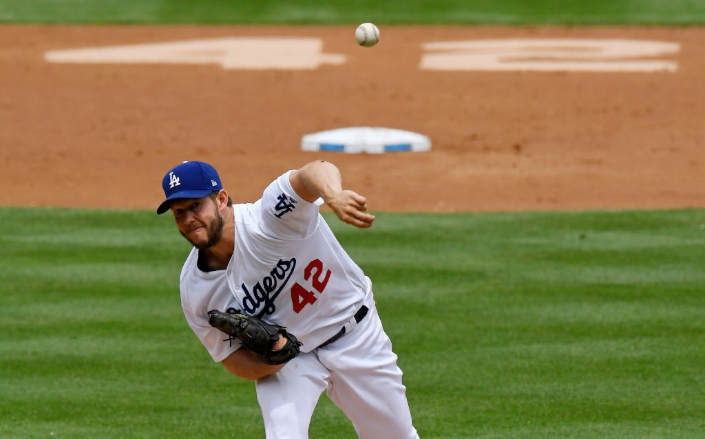 Los Angeles Dodgers starting pitcher Clayton Kershaw throws to the plate during the second inning of a baseball game against the Arizona Diamondbacks,