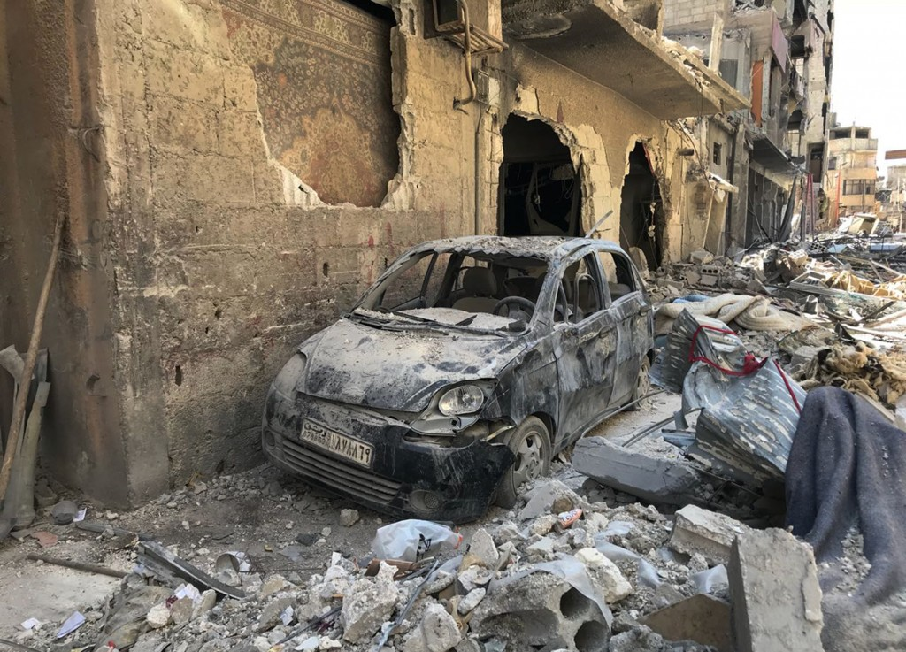 Rubble lines a street in Douma, the site of a suspected chemical weapons attack, near Damascus, Syria, Monday, April 16, 2018. Faisal Mekdad, Syria's