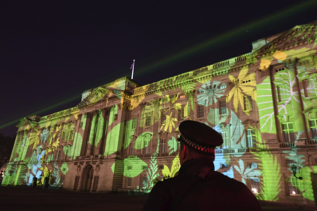 A Rainforest design is projected onto Buckingham Palace in London on Sunday, April 15, 2018, as part of the Queen's Commonwealth Canopy project (QCC),