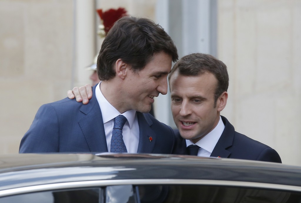 Canadian Prime Minister Justin Trudeau, left, says goodbye to French President Emmanuel Macron after a meeting at the Elysee Palace in Paris, Monday,