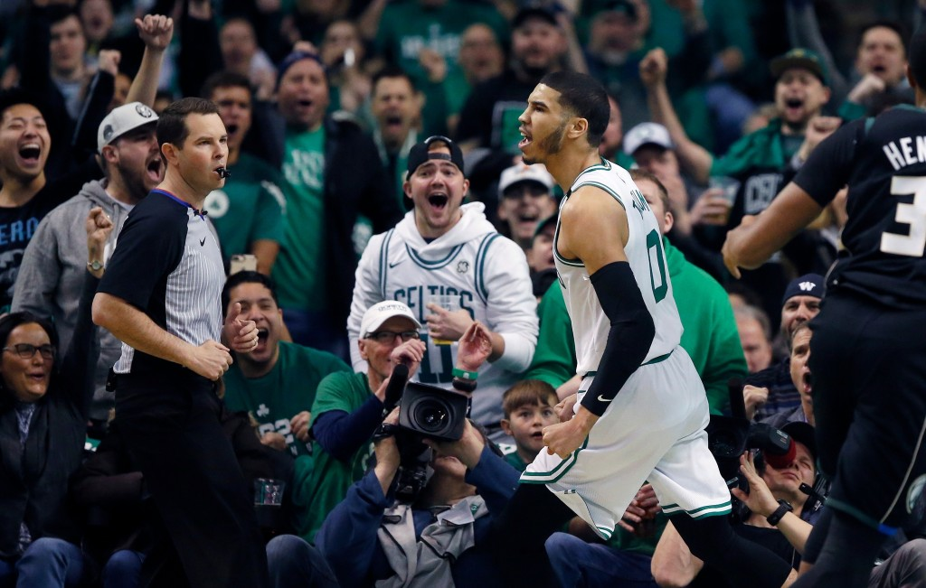 Boston Celtics' Jayson Tatum reacts after scoring during the first quarter of Game 1 of an NBA basketball first-round playoff series against the Milwa