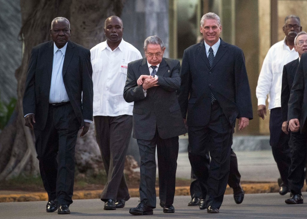 FILE - In this Jan. 28, 2018 file photo, Cuba's President Raul Castro looks at his watch as he walks with Cuba's Vice President Miguel Diaz-Canel Berm