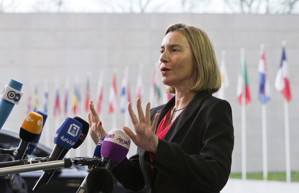 European Union foreign policy chief Federica Mogherini speaks with the media as she arrives for a meeting of EU foreign ministers at the EU Council bu