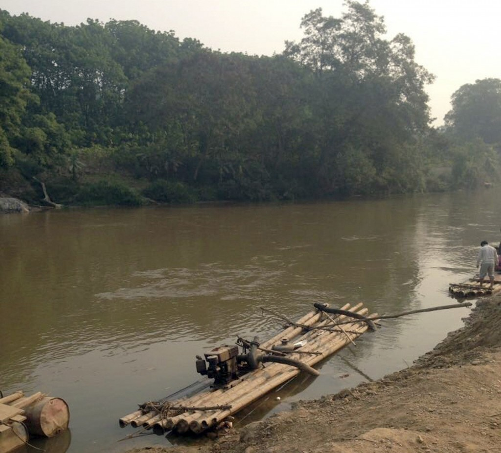 In this March 16, 2014, photo released by China Ministries International, one of the rafts that Rev. John Sanqiang Cao used to cross the river into ne