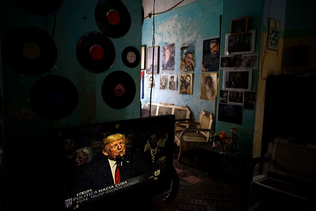 FILE - In this June 16, 2017 file photo, a television set shows U.S. President Donald Trump announcing his new Cuba policy, declaring he was restoring