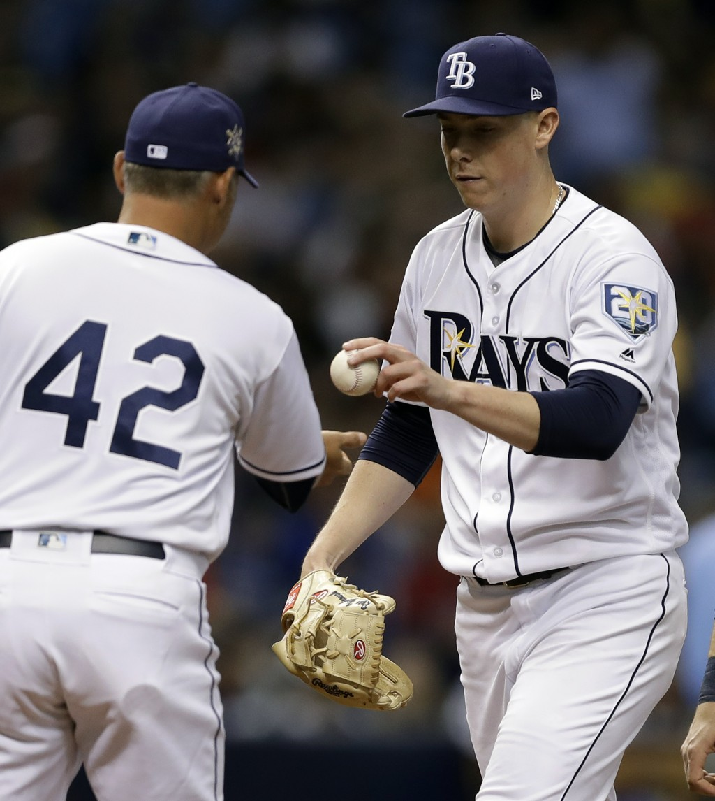 Tampa Bay Rays manager Kevin Cash left, takes pitcher Ryan Yarbrough out of the game against the Philadelphia Phillies during the fourth inning of a b