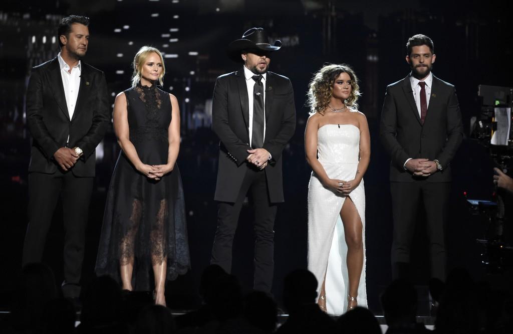 Luke Bryan, from left, Miranda Lambert, Jason Aldean, Maren Morris and Thomas Rhett speak at the 53rd annual Academy of Country Music Awards at the MG