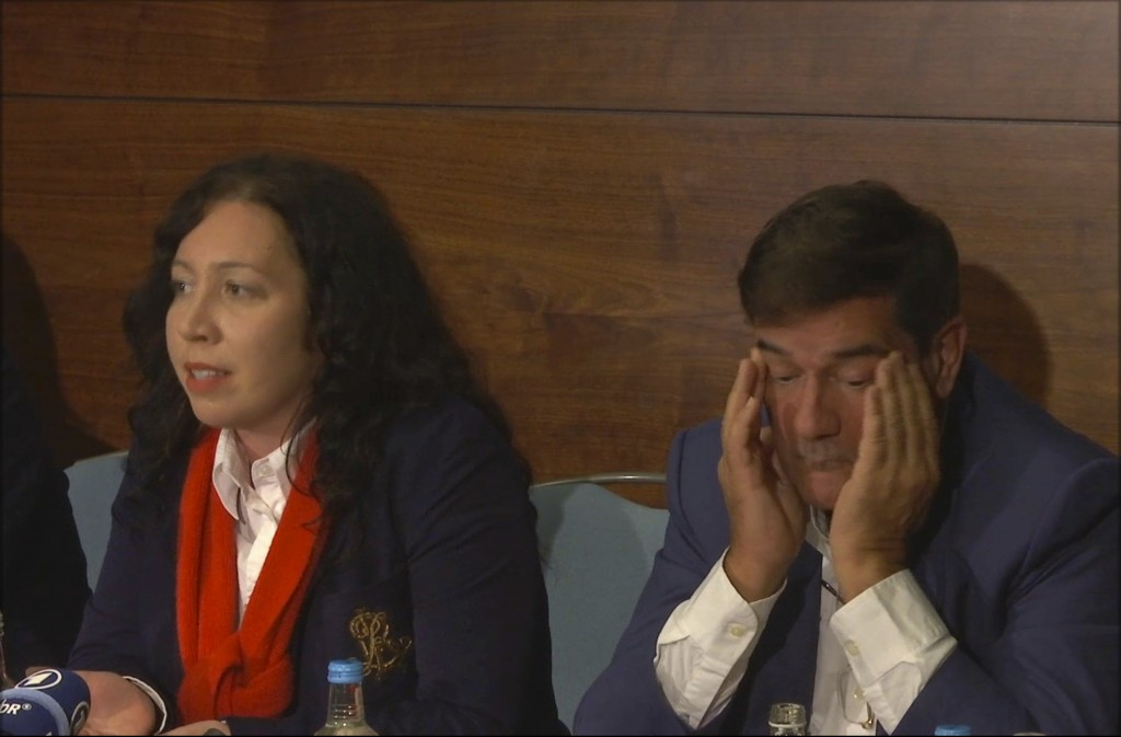 This Thursday, April 12, 2018 image from video, shows Herve Jaubert, right, a former agent of the French DGSE spy agency, speaking during a press conf