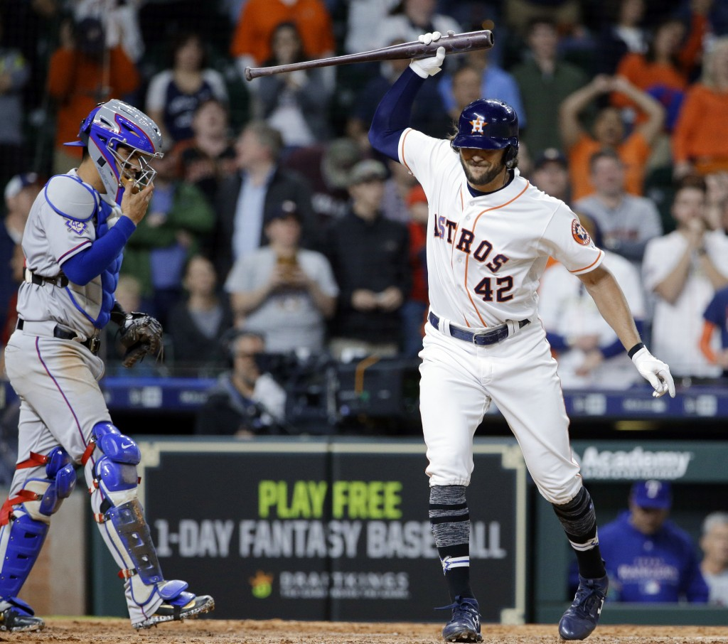 Houston Astros' Jake Marisnick, right, throws down his bat in front of Texas Rangers catcher Robinson Chirinos after striking out on a full count with