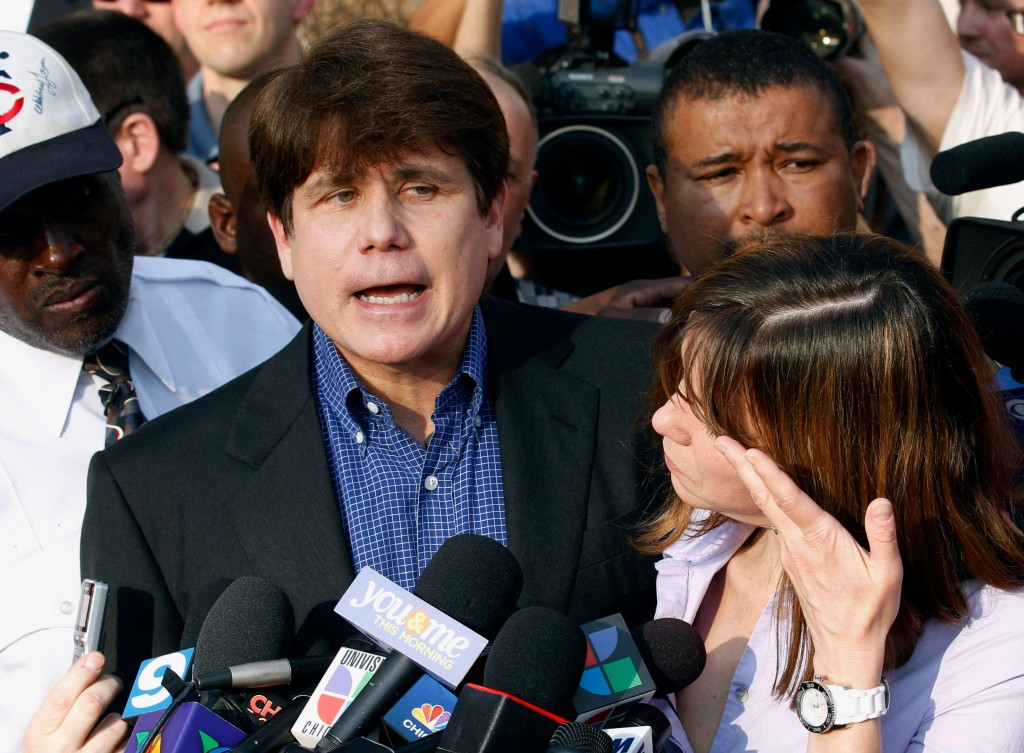 FILE - In this March 14, 2012, file photo, former Illinois Gov. Rod Blagojevich speaks to the media outside his home in Chicago as his wife, Patti, wi