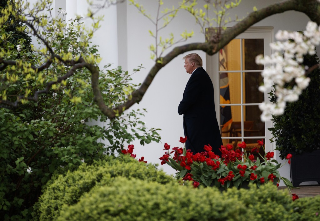 President Donald Trump walks from the Oval Office of the White House to Marine One in Washington, Monday, April 16, 2018, for the short trip to Andrew