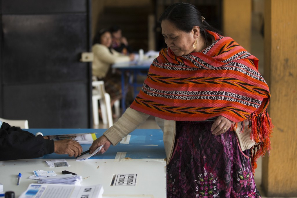 An indigenous woman casts her vote during a plebiscite concerning a border dispute with Belize, in San Pedro Sacatepequez, Guatemala, Sunday, April 15
