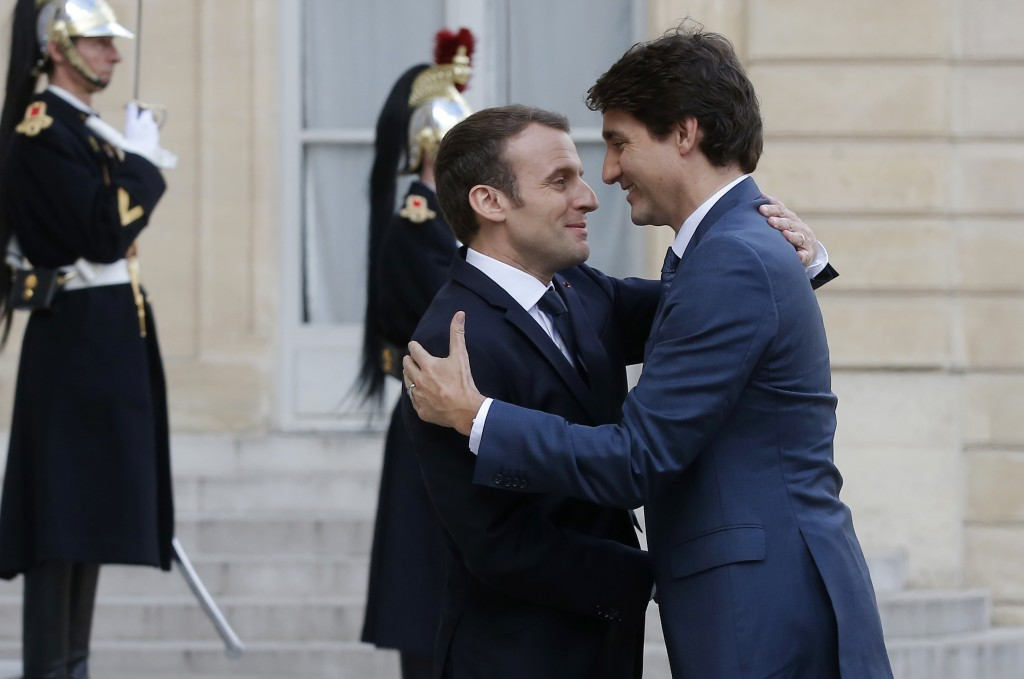 French President Emmanuel Macron, left, welcomes Canadian Prime Minister Justin Trudeau at the Elysee Palace in Paris, Monday, April 16, 2018. Trudeau