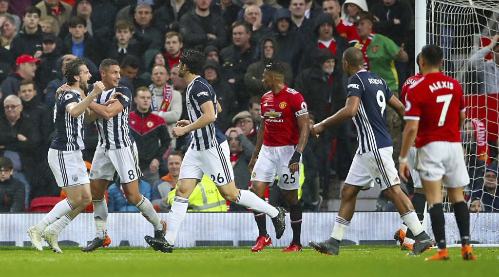 West Bromwich Albion's Jay Rodriguez, left, celebrates scoring his side's first goal of the game against Manchester United during the English Premier