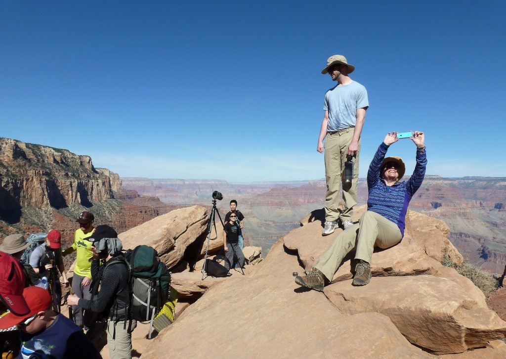 FILE - In this March 16, 2015, file photo, hikers stop and take photos along the Grand Canyon National Park's South Kaibab trail. With diverse landsca