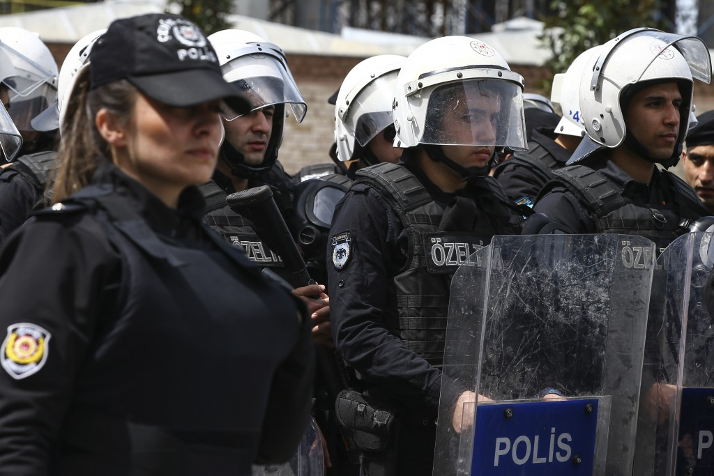 Turkey's police officers look on as supporters of Turkey's main opposition Republican People's Party, CHP, gather for a sit-in protest near central Is