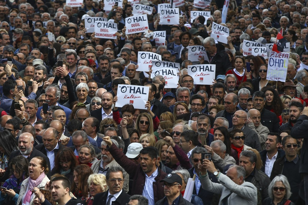 Hundreds of supporters of Turkey's main opposition Republican People's Party, CHP, gather for a sit-in protest near central Istanbul's Taksim Square,