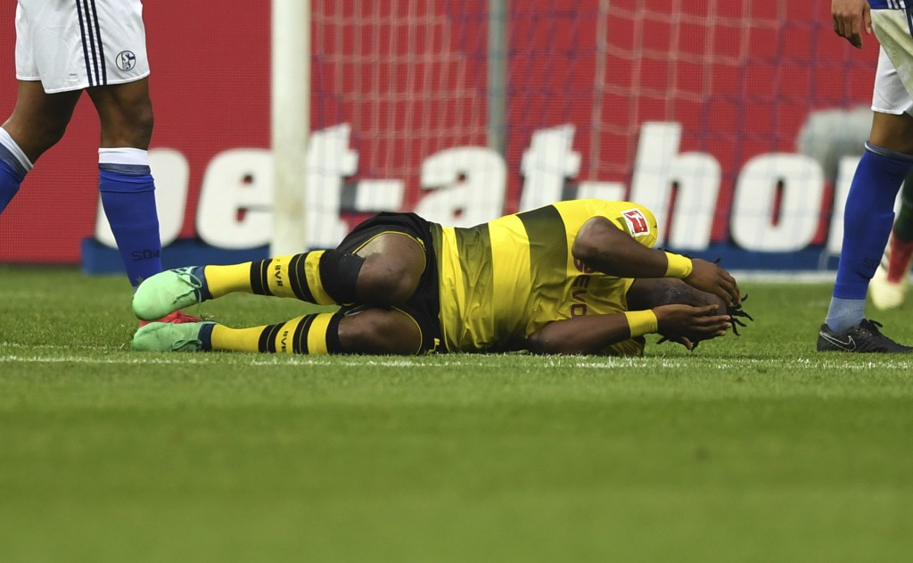 In this April 15, 2018 photo Borussia Dortmund's Michy Batshuayi covers his face in pain during the soccer Bundesliga match between FC Schalke 04 and