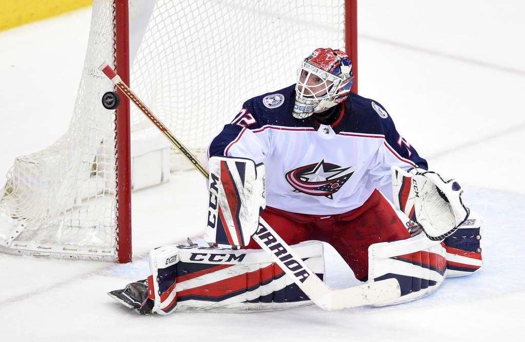 Columbus Blue Jackets goaltender Sergei Bobrovsky (72), of Russia, stops the puck during the third period in Game 2 of an NHL first-round hockey playo