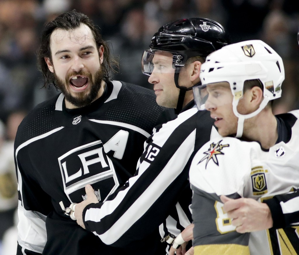 Los Angeles Kings defenseman Drew Doughty reacts after getting hit with a stick by Vegas Golden Knights center Jonathan Marchessault during the second