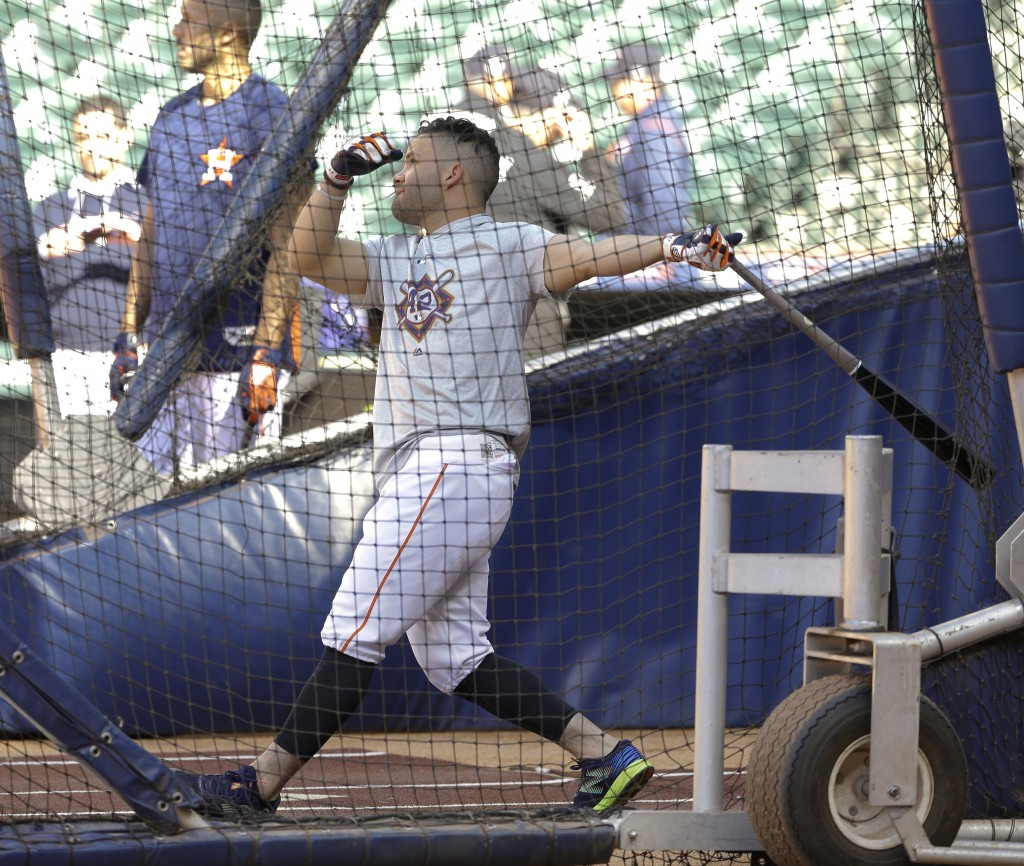 Houston Astros' Jose Altuve takes batting practice before a baseball game against the Texas Rangers, Sunday, April 15, 2018, in Houston. Both teams wo