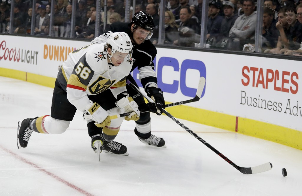 Vegas Golden Knights left wing Erik Haula, left, battles Los Angeles Kings defenseman Dion Phaneuf for the puck during the first period of Game 3 of a