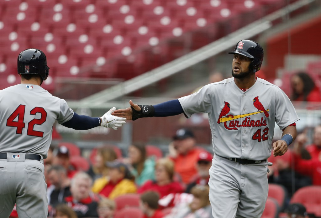 St. Louis Cardinals' Jose Martinez, right, slaps hands with Greg Garcia after scoring on a hit by Yadier Molina during the seventh inning of a basebal