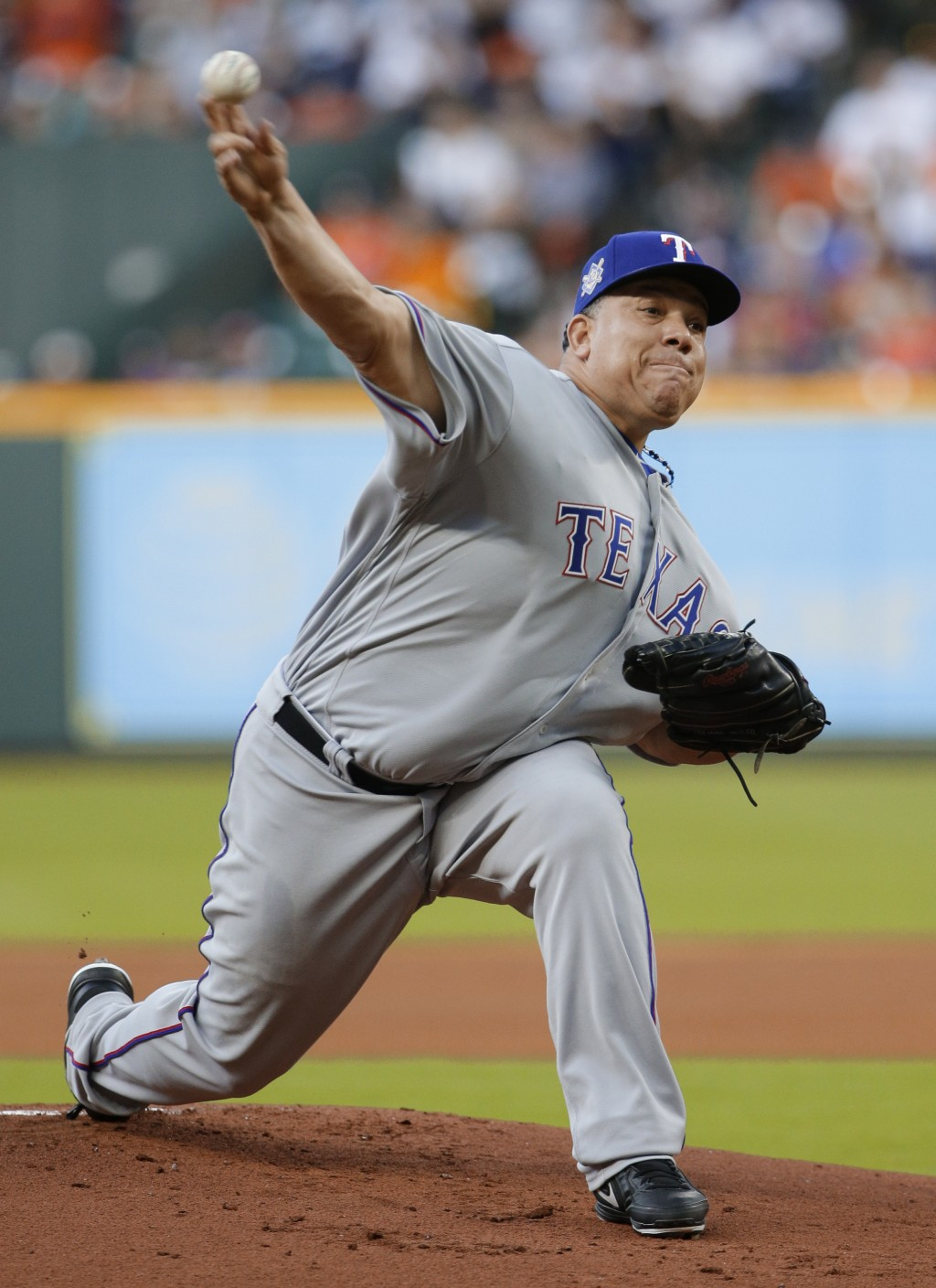 Texas Rangers' starting pitcher Bartolo Colon throws against the Houston Astros during the first inning of a baseball game Sunday, April 15, 2018, in